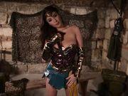 Яркая амазонка в сексуальном наряде мастурбирует