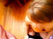 Рыжая девушка умело проводит языком по члену парня и принимает сперму на свое тело